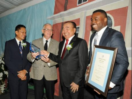 Hall of Fame 2018 Inductee Philip Wong (second right) with Old Boys (from left) - STGC Hall of Fame Chairman Donovan Chen See; Ronald Thwaites and Jezeel Martin.