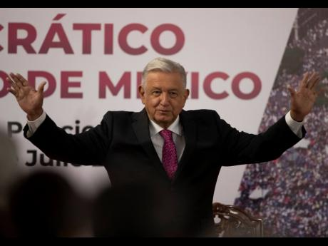 """Mexican President Andrés Manuel López Obrador waves to the crowd at a ceremony. Obrador argued last week that the time has come for a """"new coexistence"""" among the countries of the Americas."""
