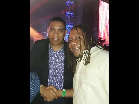 Sean 'Contractor' Edwards (right) and Prime Minister Andrew Holness at the Air Supply concert at Couples San Souci in May 2019.