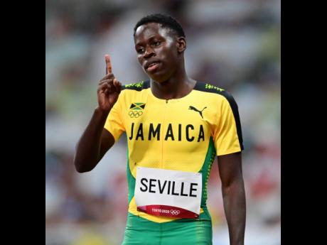 Jamaica's Oblique Seville reacts after competing in the men's 100m first round at the Tokyo 2020 Olympics at the Tokyo Olympic Stadium in Tokyo, Japan yesterday.