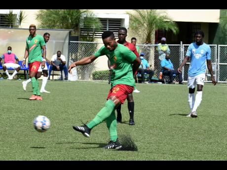 Humble Lion's Andrew Vanzie takes a shot at goal during yesterdays' Jamaica Premier League (JPL) football match between Humble Lion and Waterhouse at the UWI/Captain Horace Burrell Centre of Excellence. Vanzie scored both goals as Humble Lion won 2-1.