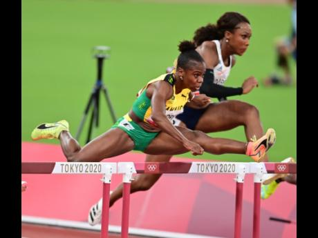 National champion Megan Tapper with a clean leap in the Women's 100m Hurdles semi-final at the Tokyo Olympic Games in Tokyo, Japan on Sunday.