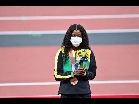 Right: Bronze medallist Shericka Jackson finished third in the women's 100 metres, which saw Jamaica making a clean sweep of the event.