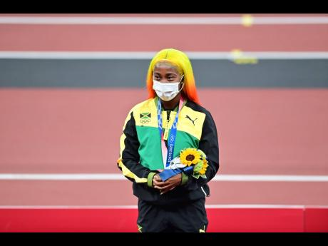Far right: Double Olympic 100 metres champion Shelly-Ann Fraser-Pryce got silver in the 100 metres event.