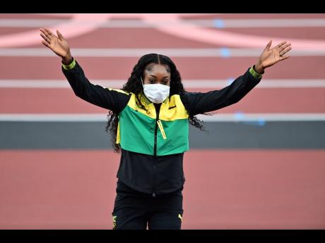 Centre: Jamaica's Elaine Thompson-Herah on the podium at the Olympic Stadium in Toyko, Japan, on Sunday, August 1. Thompson-Herah led a 1-2-3 sweep in the women's 100m final.