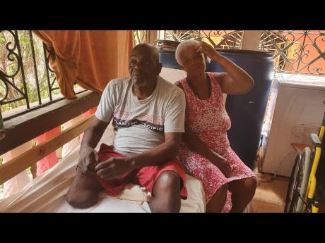 Amputee Castel Cunningham and his wife Millicent Clarke, who are both diabetics, are two of the 110 recipients of the i-doc health club card that is being issued to people unable to afford some healthcare services or access medical facilities in the public