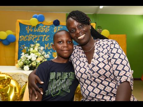 Alechia Anderson-Douglas with her son Jalill Douglas from Yallahs Primary School, St Thomas. Jalill aced PEP  with perfect scores and will be attending Campion College.