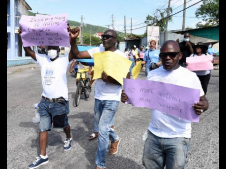 Scores of residents from August Town in St Andrew turned out yesterday for an anti-violence march through several communities calling for peace and an end to gang warfare.