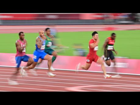 Italy's Lamont Marcell Jacob (second left) in action in the Men's 100m semi-final at the Tokyo Olympic Games in Tokyo, Japan, yesterday.