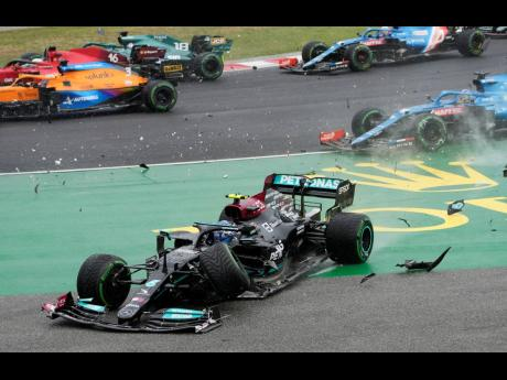 Mercedes driver Valtteri Bottas of Finland is involved in a multicar crash during the Hungarian Formula One Grand Prix at the Hungaroring racetrack in Mogyorod, Hungary, yesterday.