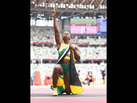 Megan Tapper celebrates after claiming Jamaica's first ever medal, a bronze, in the Women's 100m Hurdles event at the Tokyo Olympic Games in Tokyo, Japan, on Monday.