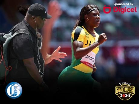 MVP Track Club coach Stephen Francis (left) and sprinter Shericka Jackson.
