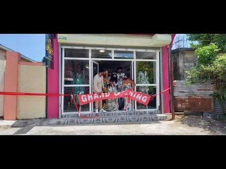 Theresa White cuts the ribbon to officially open ChicByT store in Port Antonio, Portland.
