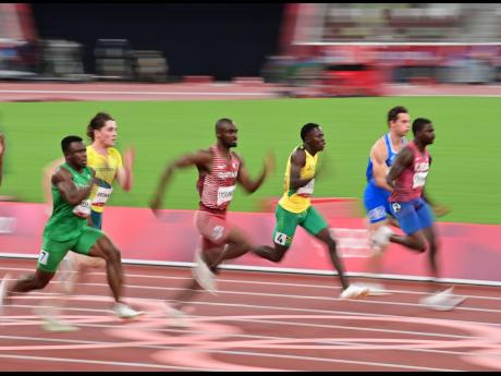 Jamaica's Oblique Seville (third right) competing in the men's 100 metres semi-final at the Tokyo 2020 Olympics at the Tokyo Olympic Stadium in Tokyo, Japan, on Sunday.