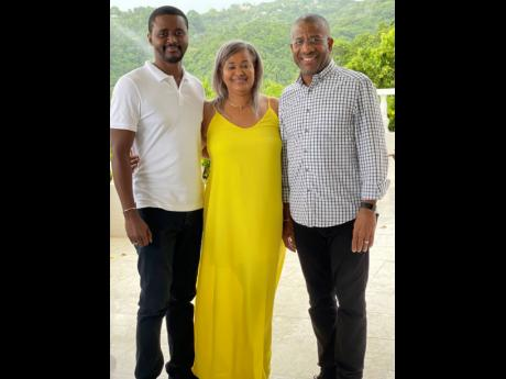 Maureen Edwards (centre) is sandwiched by son, Carlton Williams, and husband,  Errol Edwards.