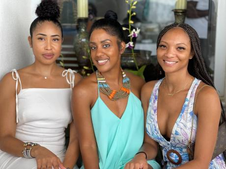 From left: Adonia Chin, Kellie Moyneaux, and Sunny Siddons at Sandra Molyneaux's birthday party at Tamarind Hill, Hanover, last weekend.