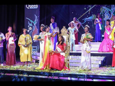 Miss Jamaica Festival Queen 2019 Khamara Wright (left) crowns her successor, Miss Manchester Dr Dominique Reid.