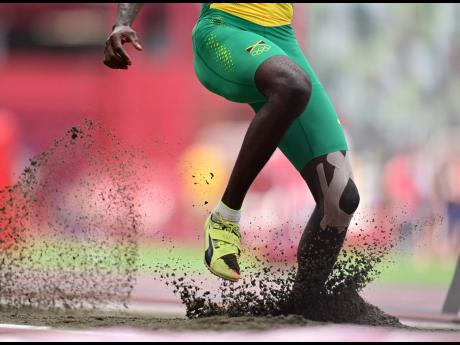 The heavily bandaged knee of Tajay Gayle, who was unable to advance to the top eight of the long jump final.