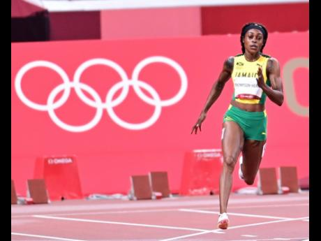 Elaine Thompson-Herah competing in the 200m semi-finals at the Tokyo 2020 Olympic Games on Monday. She could become the first woman to claim consecutive double sprint titles in Olympic history.