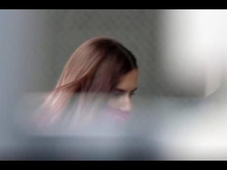In this image made from video provided by NTV, Belarus Olympic sprinter Krystsina Tsimanouskaya enters the Polish embassy in Tokyo, Japan, yesterday.