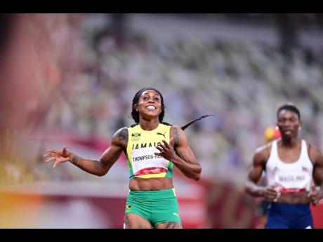 Jamaica's Elaine Thompson Herah smiles after crossing the line to win the Women's 200m final at the Tokyo Olympic Games in Tokyo, Japan on Tuesday.