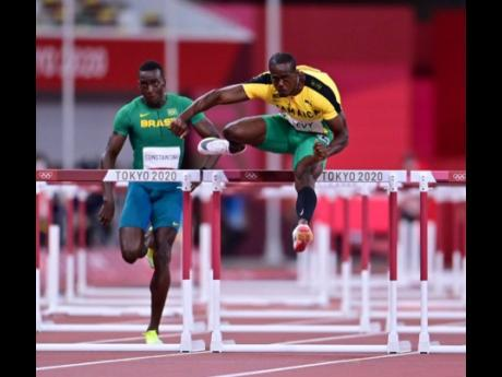 Jamaica's Ronald Levy (right) clears his hurdle ahead of Brazil's Gabriel Constantino to take the win in the opening round of the Men's 110m hurdles event at the Tokyo Olympic Games in Tokyo, Japan on Tuesday.