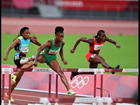 Jamaica's Britany Anderson (centre) competing in the women's 100 metres hurdles semi-final at the Tokyo 2020 Olympics at the Tokyo Olympic Stadium in Tokyo, Japan, on Sunday.