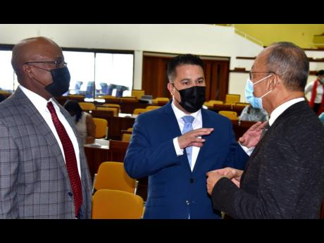 Minister of National Security and Deputy Prime Minister Dr Horace Chang (right) in discussion with minister without portfolio in the Ministry of National Security, Senator Matthew Samuda (centre), and Commissioner of Corrections, Lt Col (Ret'd) Gary Rowe