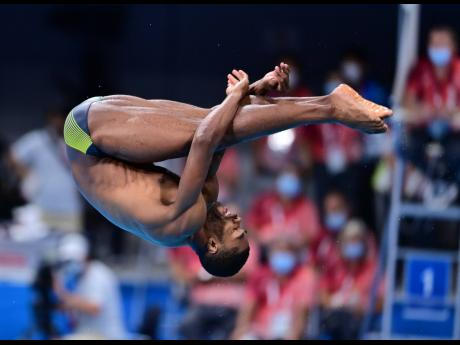 Yona Knight-Wisdom competing in the men's three-metre springboard diving at the Tokyo 2020 Olympic Games inside the Tokyo Aquatic Centre in Japan on Monday.
