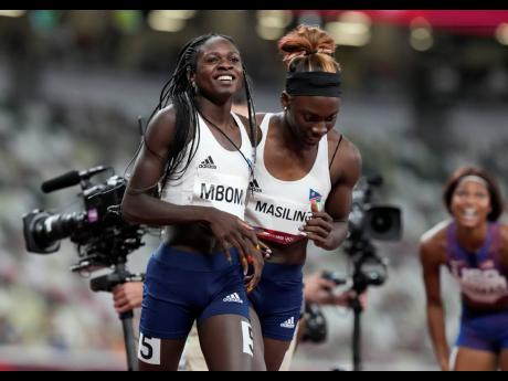 Christine Mboma, of Namibia, celebrates with Beatrice Masilingi, of Namibia after winning the silver medal in the final of the Women's 200m event at the 2020 Summer Olympics, in Tokyo Japan yesterday.