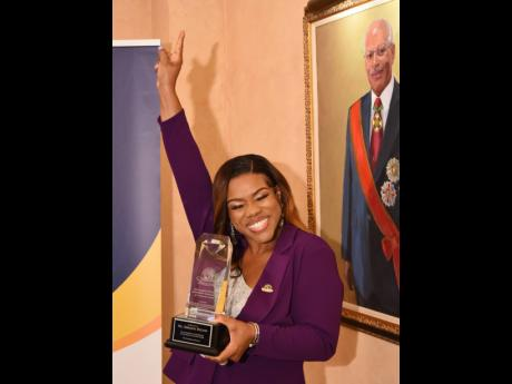Khadine 'Miss Kitty' Hylton, media practitioner and attorney-at-law, celebrates after being presented with the special 30th anniversary Governor General's Achievement Award for the county of Surrey in recognition of her outstanding community service,