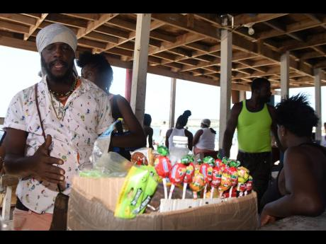 Keno, who sells sweets at the Hellshire Beach.