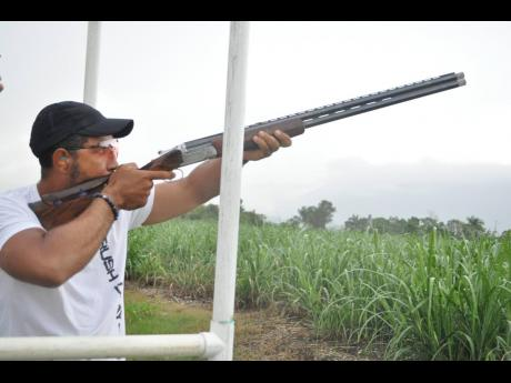 Top gunner, Shaun Barnes, takes aim at a target at the 200 Summer Open Sporting Clays at the Worthy Park Estate in St Catherine at the weekend.