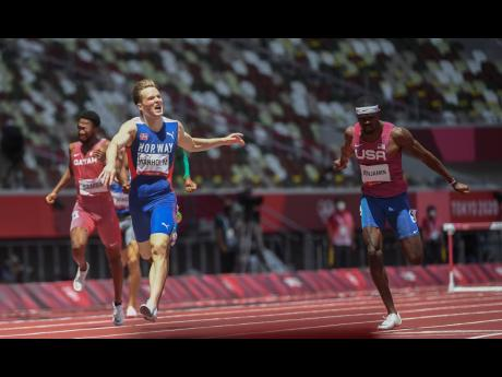 Karsten Warholm of Norway  (left) breaks the world record, winning the Men's 400m Hurdles final ahead of the USA's Rai Benjamin (right) at the Tokyo 2020 Olympics Games in Tokyo, Japan yesterday.