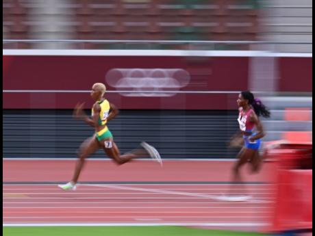 Jamaica's Candice McLeod (left) just ahead of the USA's Quanera Hayes in the Women's 400m semi-finals at the 2020 Olympics Games in Tokyo, Japan on Wednesday.
