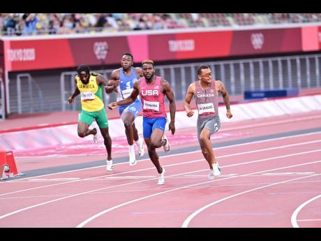 Canada's Andre de Grasse (right) crosses the line ahead of the USA's Kenneth Bednarek (second right) to win the Men's 200m final at the Olympic Games in Tokyo, Japan on Wednesday. Also pictured are Jamaica's Rasheed Dwyer (left), and Liberia's Joseph Fahnb