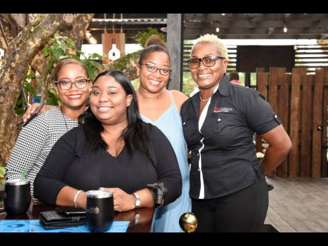 From Left: Chrystal Harewood, Kymone Booth, Annalise Harewood and Michelle Watkis-Robinson celebrate the launch of Janga's Appleton Estate Lyric Lounge.