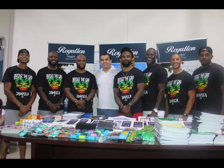 The Through Our Eyes Foundation makes a donation of tablets and other school supplies to Little London High School and Grange Hill High School as part of its Bridge The Gap: Jamaica project.