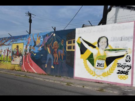 Shelly-Ann Fraser-Pryce's mural brightens up a wall on her home town, Ashoka Road, in Waterhouse, St Andrew.