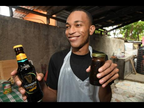 The good chef smiles for the camera while he shares more about his Guinness hot sauce.