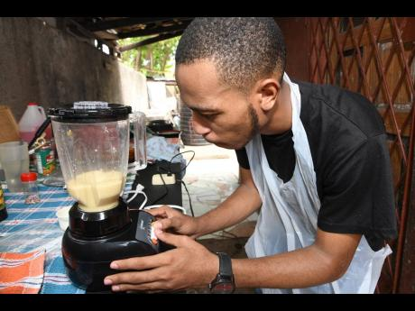 Checking for the consistency in the mix, the chef blends the boiled ackee with condensed milk and vanilla until smooth.