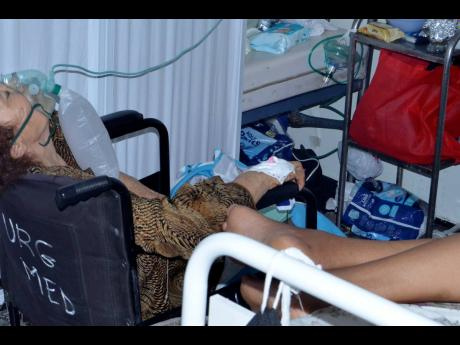 In this June 28 file photo, a COVID-19 patient breathes with the help of an oxygen mask at the Iben El Jazzar Hospital in Kairouan, Tunisia.