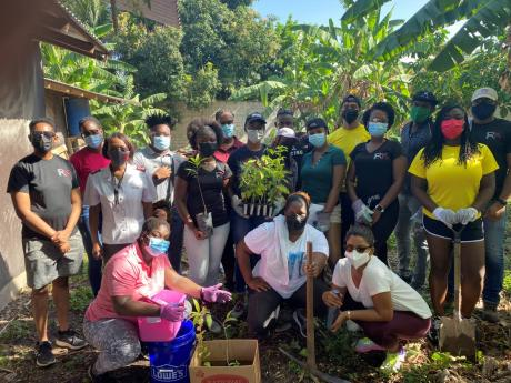 left: Team members at Rotaract Club of Kingston, together with representatives of The Salvation Army's School for the Blind and Visually Impaired Children share a photo moment before the start of their most recent tree planting initiative.