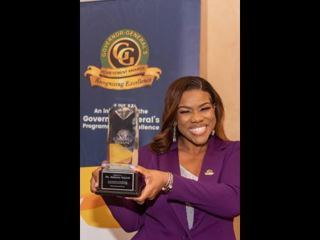 The media personality and attorney-at-law is all smiles as she shows off her special award.