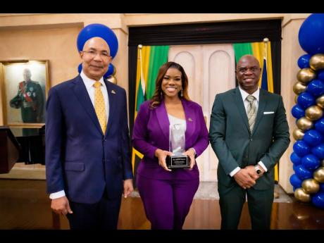 From left: Sir Patrick Allen, governor general of Jamaica; Khadine 'Miss Kitty' Hylton and Ian Wilkinson, QC.