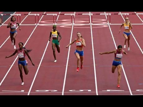 Sydney McLaughlin (second right), of the United States, wins the gold medal in the final of the Women's 400m Hurdles ahead of national teammate Dalilah Muhammad (second left), silver, and Femke Bol (third right), of the Netherlands, bronze, at the 2020 S