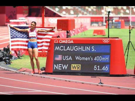 USA's Sydney McLaughlin poses by the clock while celebrating her world record run of 51.46 seconds in the Women's 400m hurdles final at the Olympic Games in Tokyo, Japan yesterday.