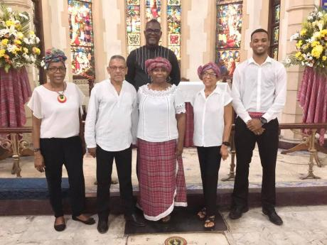 The St Andrew Parish Church choir pose for a photograph on Emancipation Day with music director Audley Davidson (back row).
