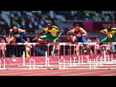 Parchment (second left) and bronze medallist Ronald Levy (right) in action in the Men's 110m Hurdles final.