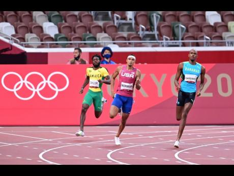 The Bahamas' Steven Gardiner (right) on his way to victory in the Men's 400m final at the Olympic Games in Tokyo, Japan on Thursday. Also pictured are Jamaica's Christopher Taylor (left) and USA's Michael Norman.